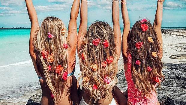 Girls on a beach with flowers in their hair