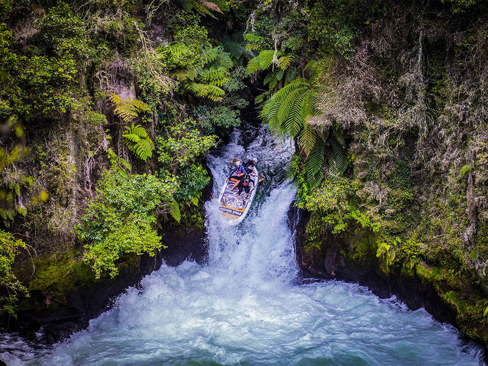 gant SUP paddling over waterfall