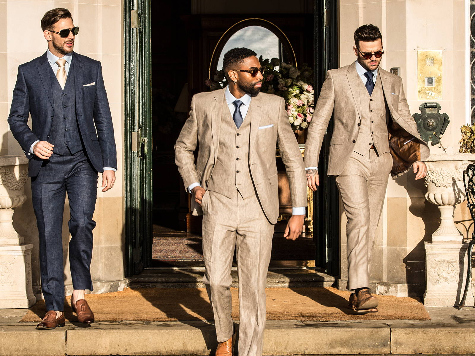 three dudes in suits