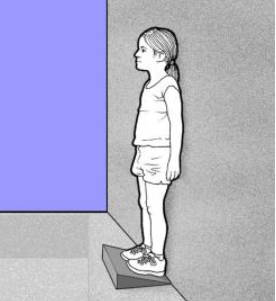 girl standing on an inclined board
