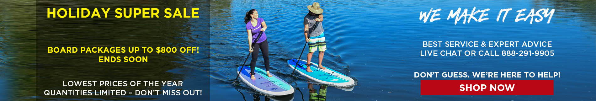 Couple of paddler boarders paddle boarding on beautiful lake during holiday