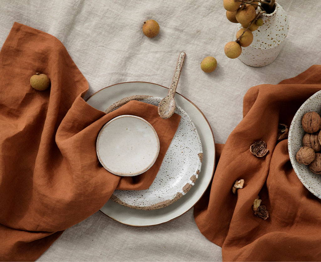 Ceramic dishes by Splendid Wren styled with the Linen Table Napkins in Cedar.