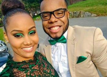 Couple wearing coordinating green outfits, including a dress, bow tie and pocket square.