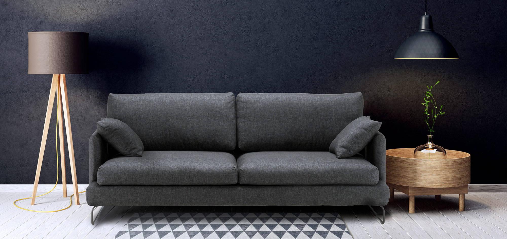 Como-sohva tummalla taustaa vasten, tumma kangas. HT Collection