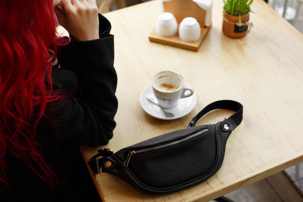 girl with black leather belt bag