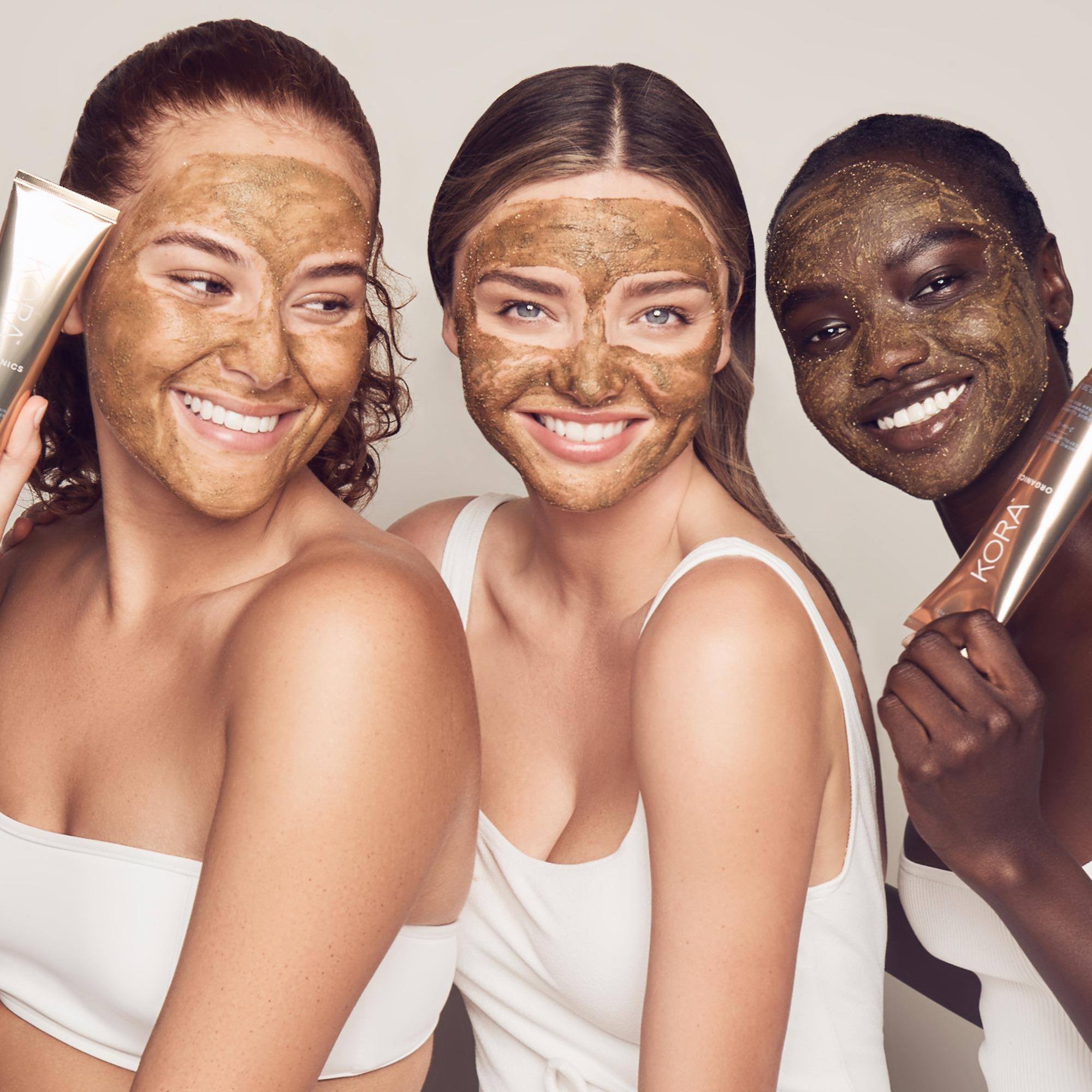 Miranda Kerr with two women wearing Turmeric Brightening & Exfoliating Mask