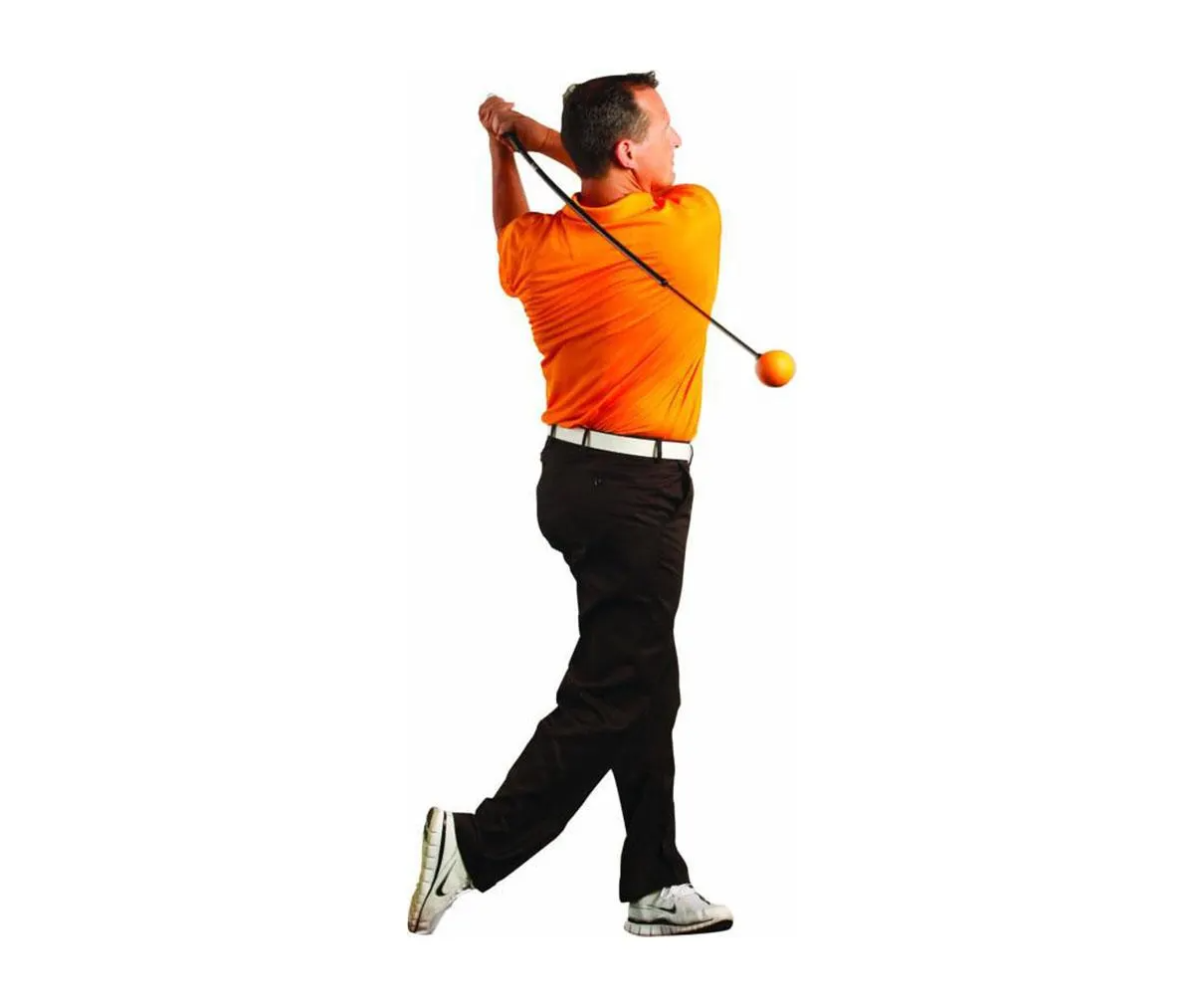 Golfer finishing practice swing with the Orange Whip trainer
