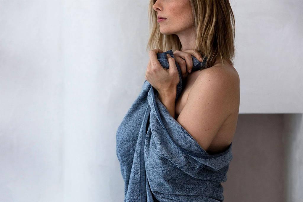 Model wrapped in the Denim Bath Towel.