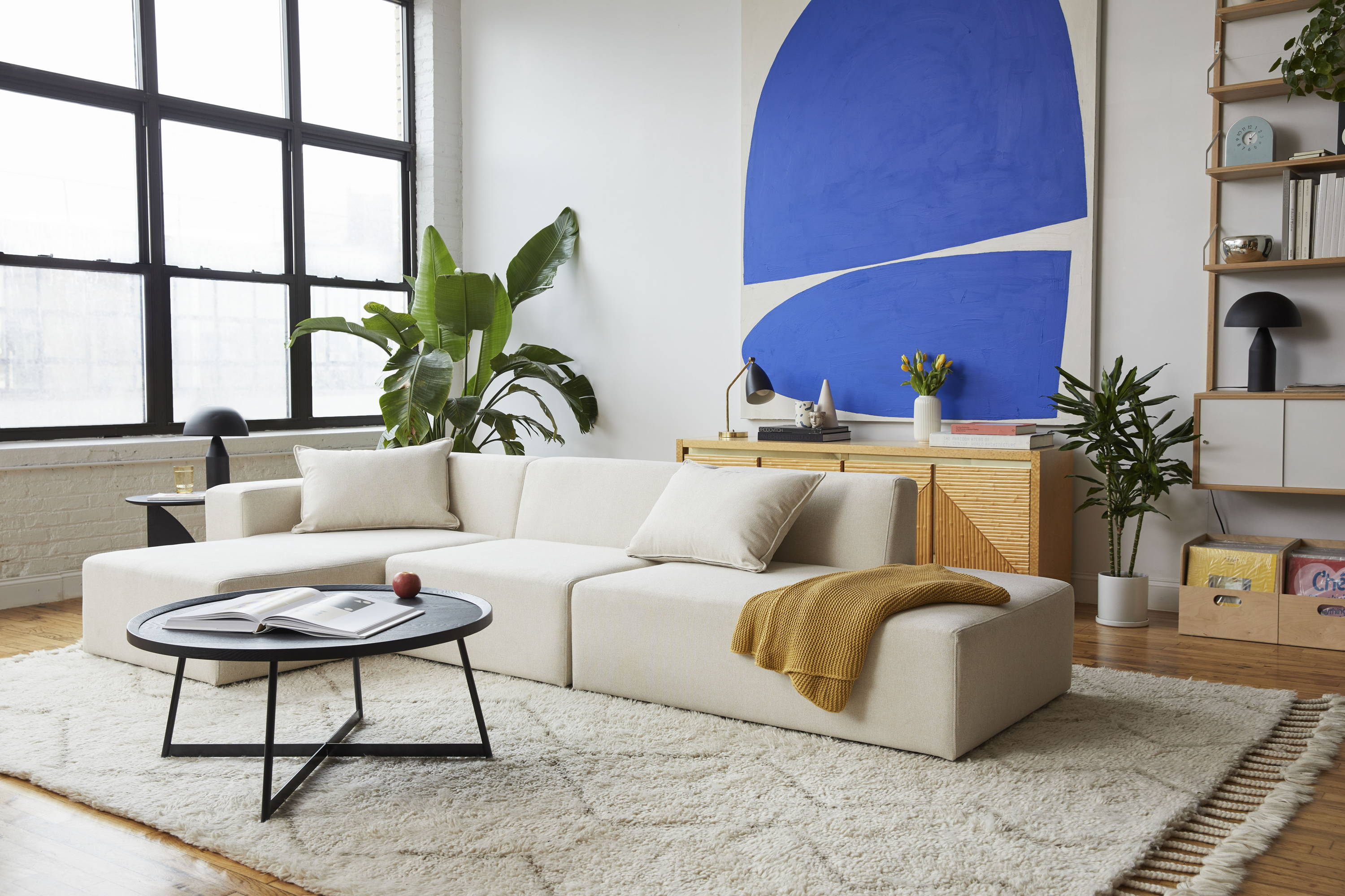 The Floyd Sectional in Off White with a chaise.