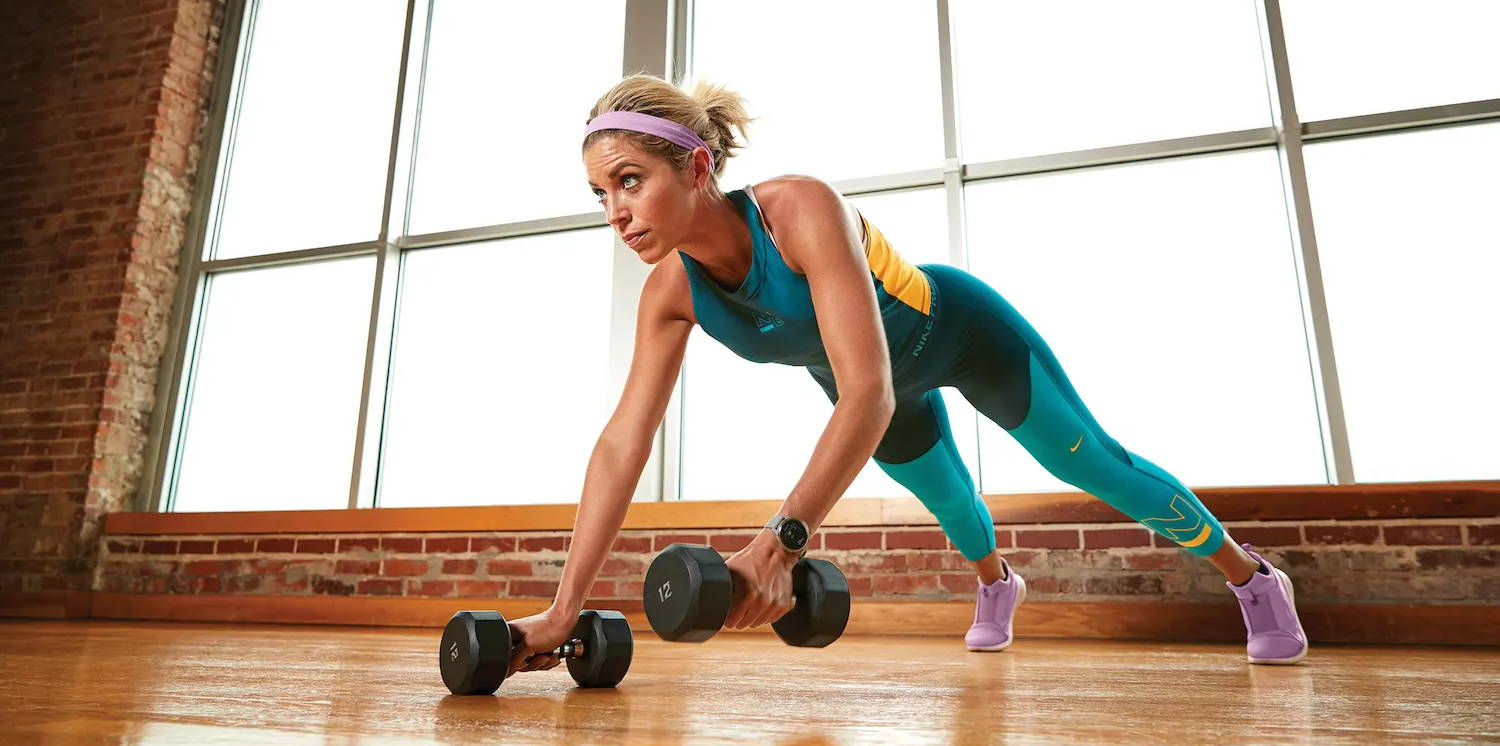 Woman performing rows with Garmin GPS smartwatch