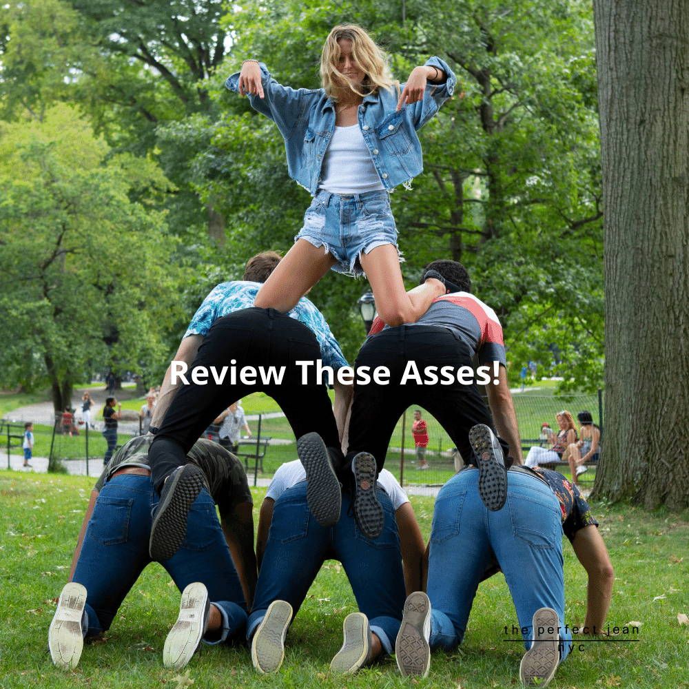 Woman on top of pyramid of men wearing The Perfect Jeans