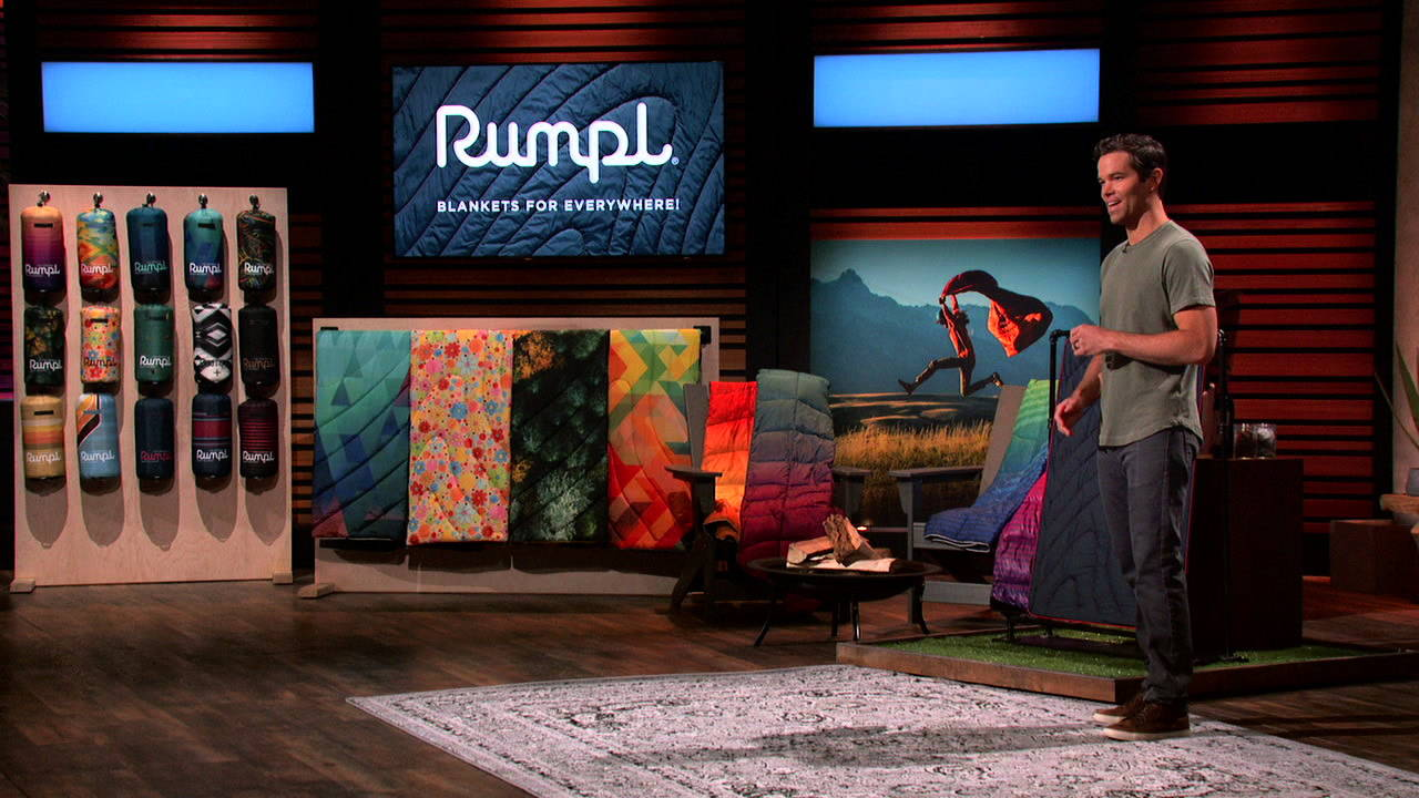 Wylie on the Shark Tank stage with Rumpl puffy blankets