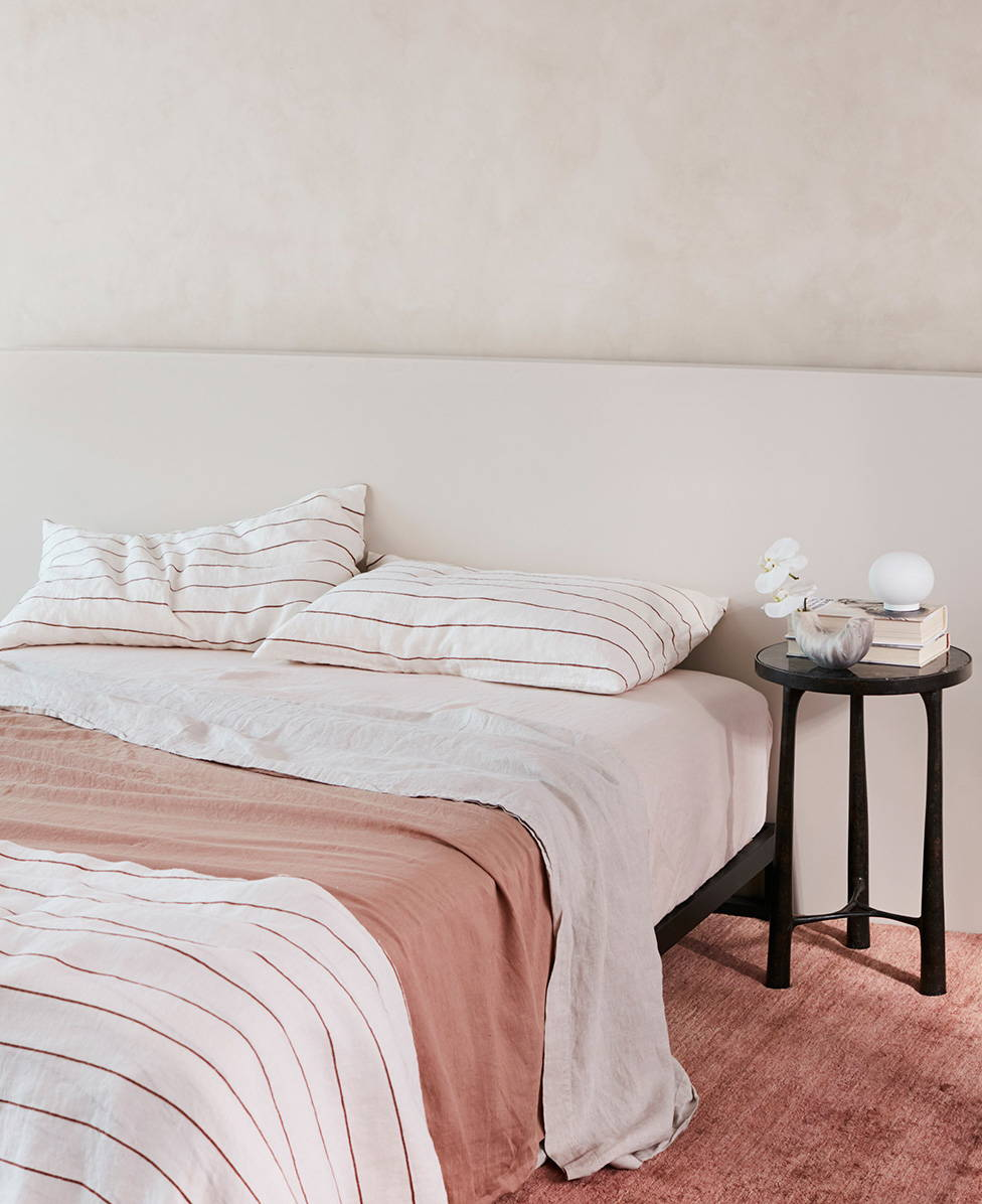 Image shows bed styled with Cultiver linen bedding in fawn, cedar stripe and smoke gray colourways.