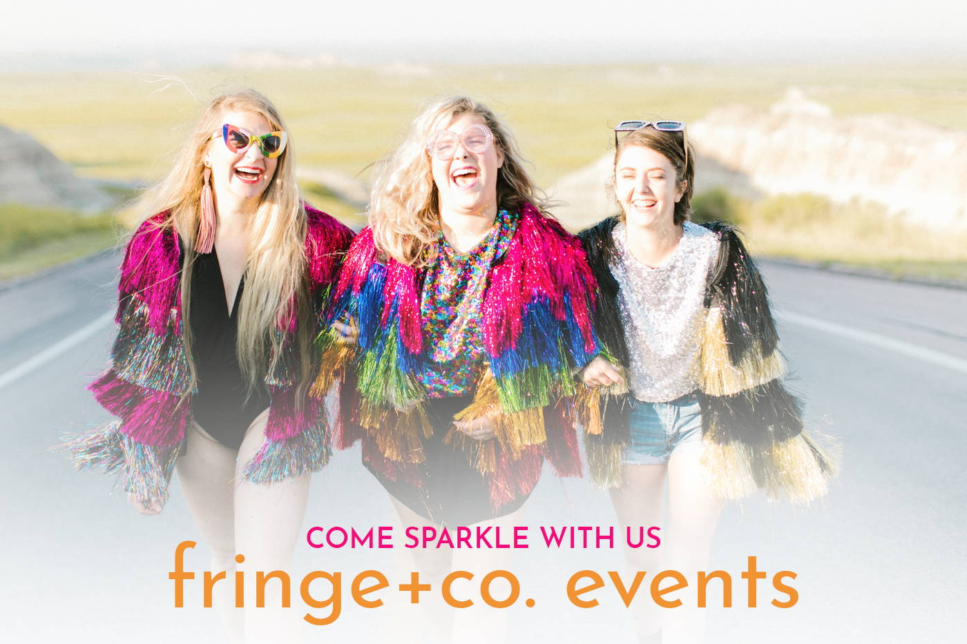 Fringe + co. event page girls in tinsel jackets laughing and walking