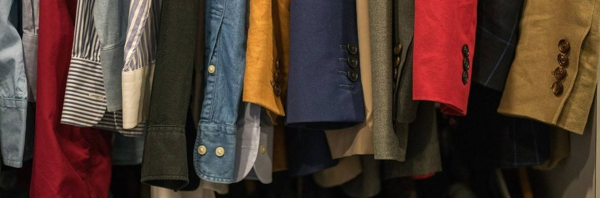 Men's second hand shirts and jackets on sale in a charity shop