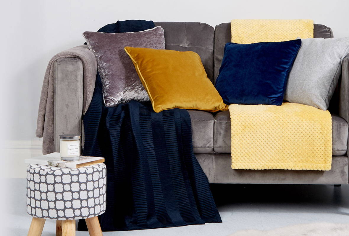 Home Furnishing, including cushions, throws, foot rests and candles