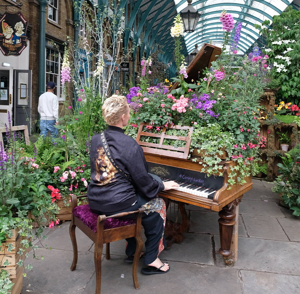 Camilla Franks playing piano, CAMILLA Jacket with Lion