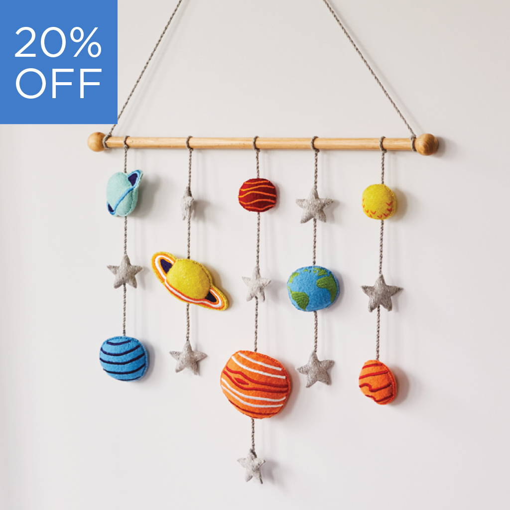 Felt wall hanging with planets and stars design.
