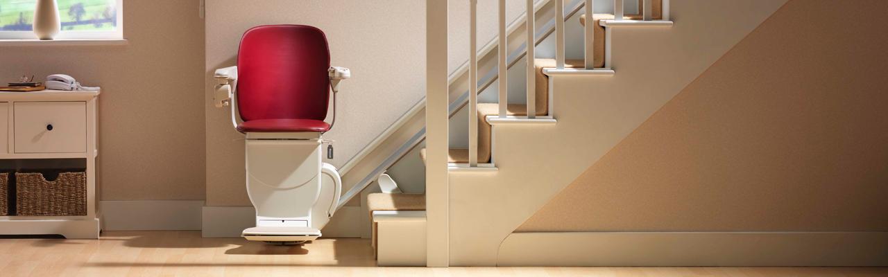 Stannah 600 siena stair lift chair red straight banner | VIVA Mobility USA - Orlando, FL