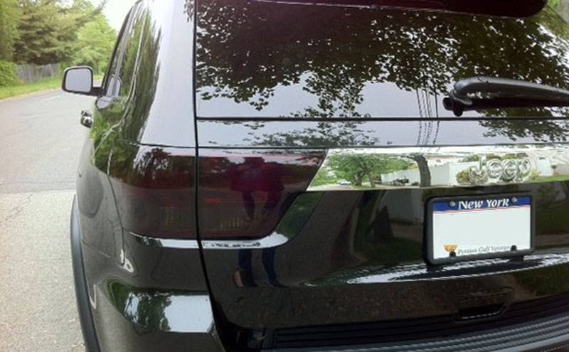Jeep Cherokee with Charcoal Lamin-x tail light tint film covers