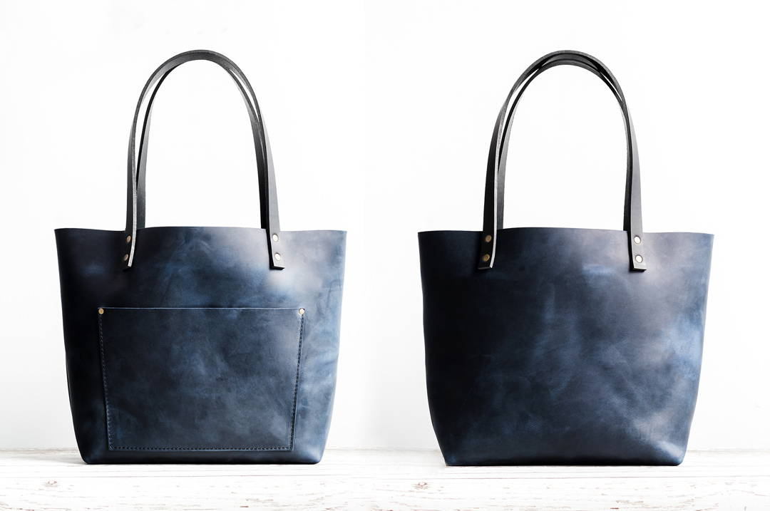 front and back view of deep blue leather tote bag