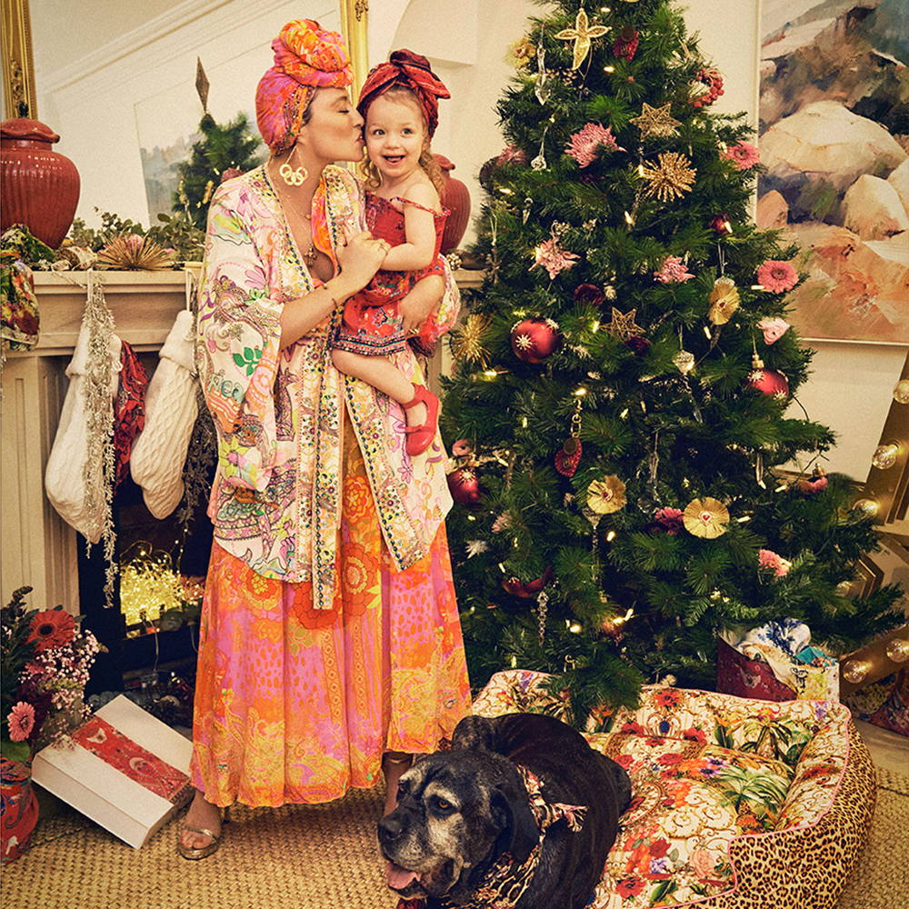 Camilla Franks and Luna next to Christmas Tree