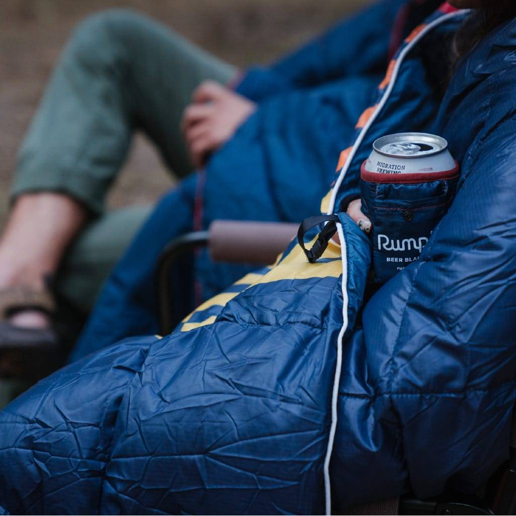 Drinking a cold beer with a rumpl blanket gift