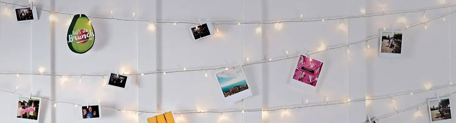 Fairy light wall illuminated with images attached to it