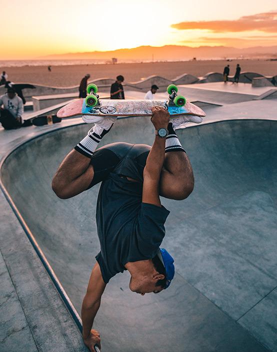 skateboarder doing trick in bowl