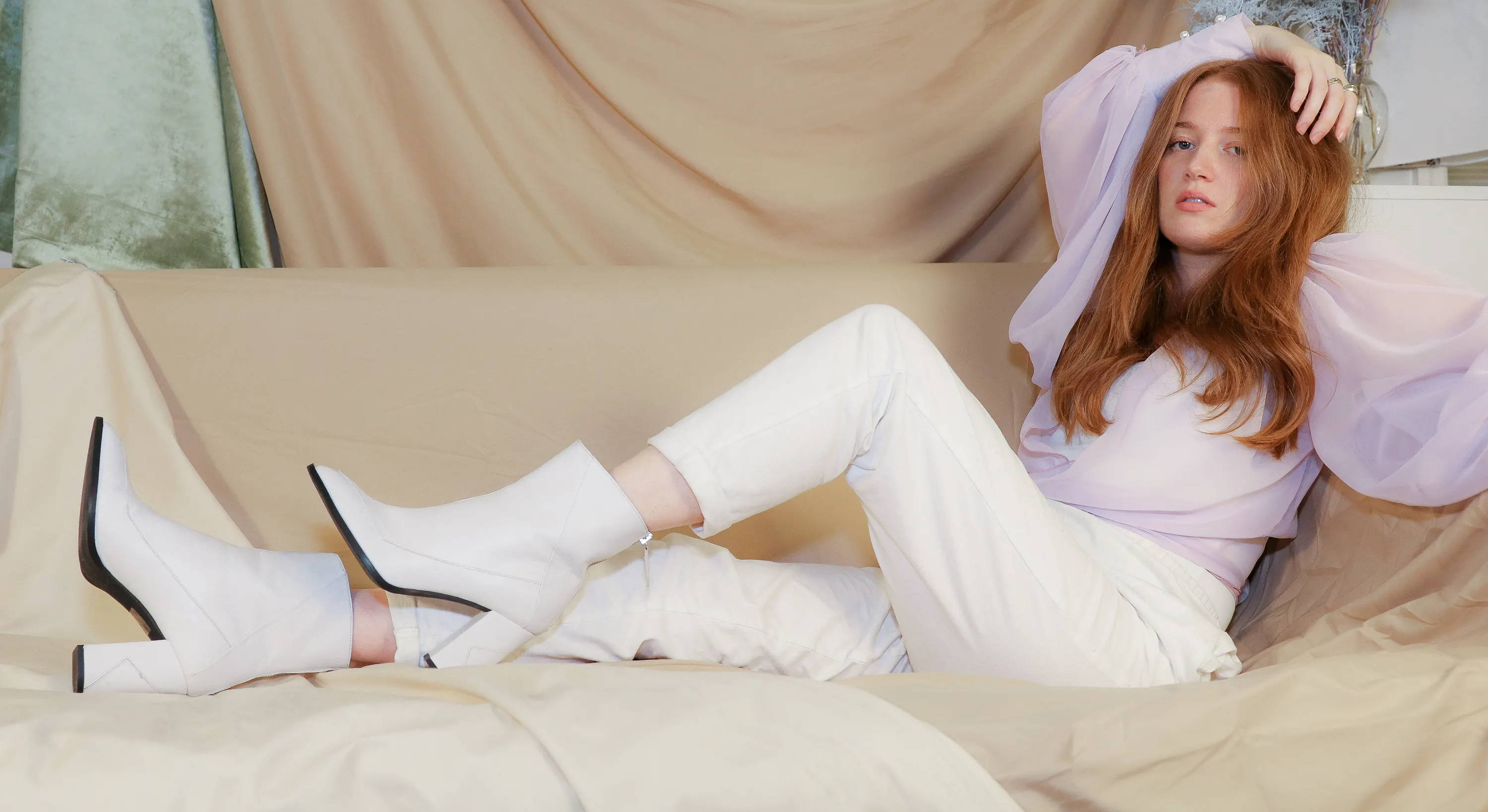 Our Almasi in white vegan apple leather on model and personality Brigette Muller