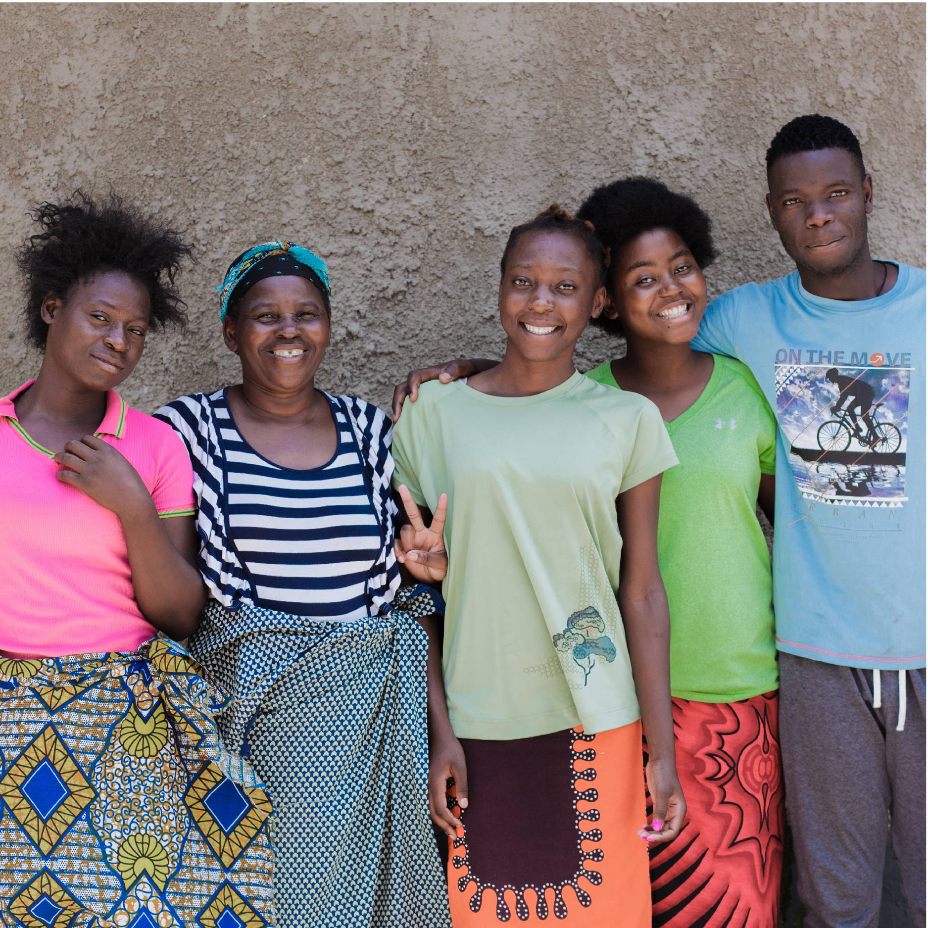 A group of Zambian teenagers stand with their house mom at one of the My Fathers House Children's Homes in Lusaka Zambia