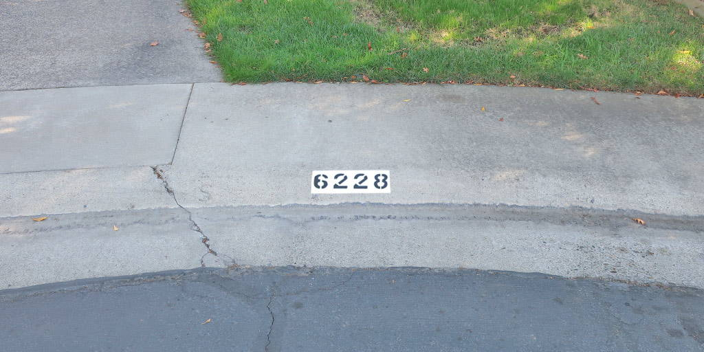 Stenciled Curb Address Number on Sidewalk