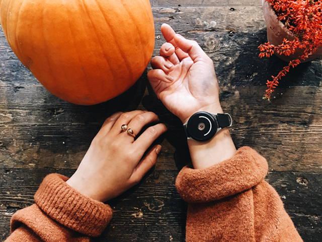 woman wearing doppel near pumpkin
