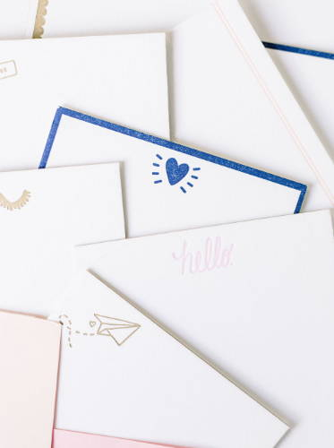 Cute stationery set with various letter pressed cards in a pile