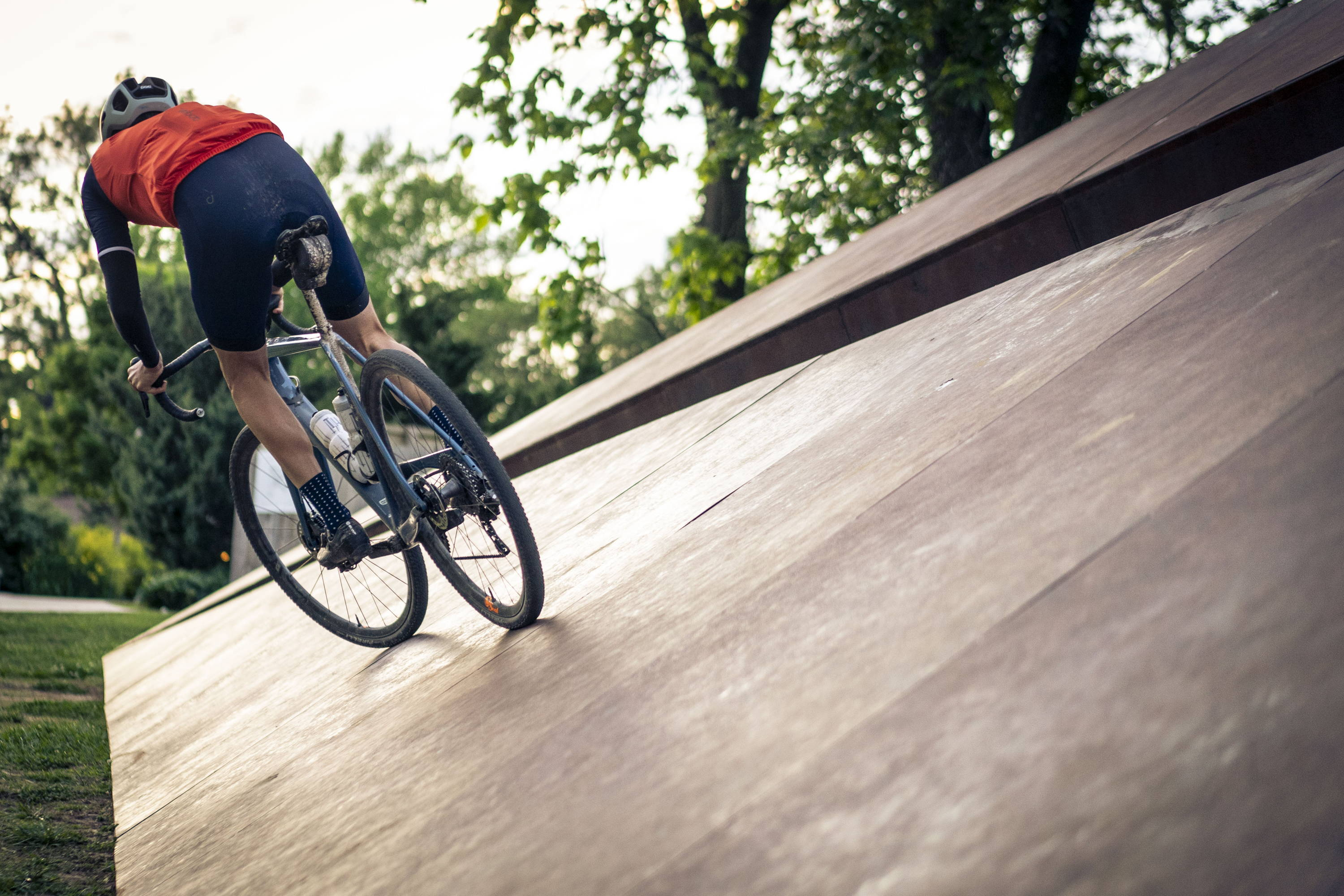 A person riding a bike on a smoothly paved path