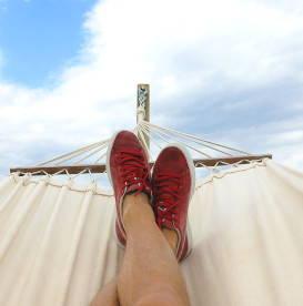 niksen-art-of-doing-nothing-lounging-in-white-hammock