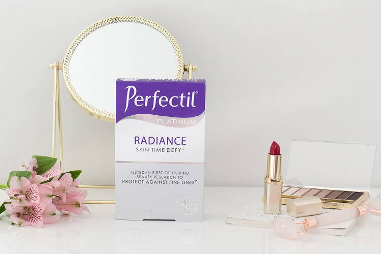 Perfectil Radiance Packshot With A Mirror, Lipstick & Eyeshadow Around It