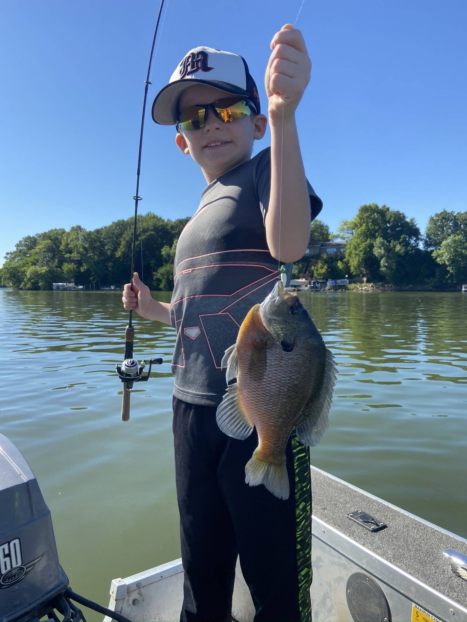Young boy with his catch using crystaleyes jigs