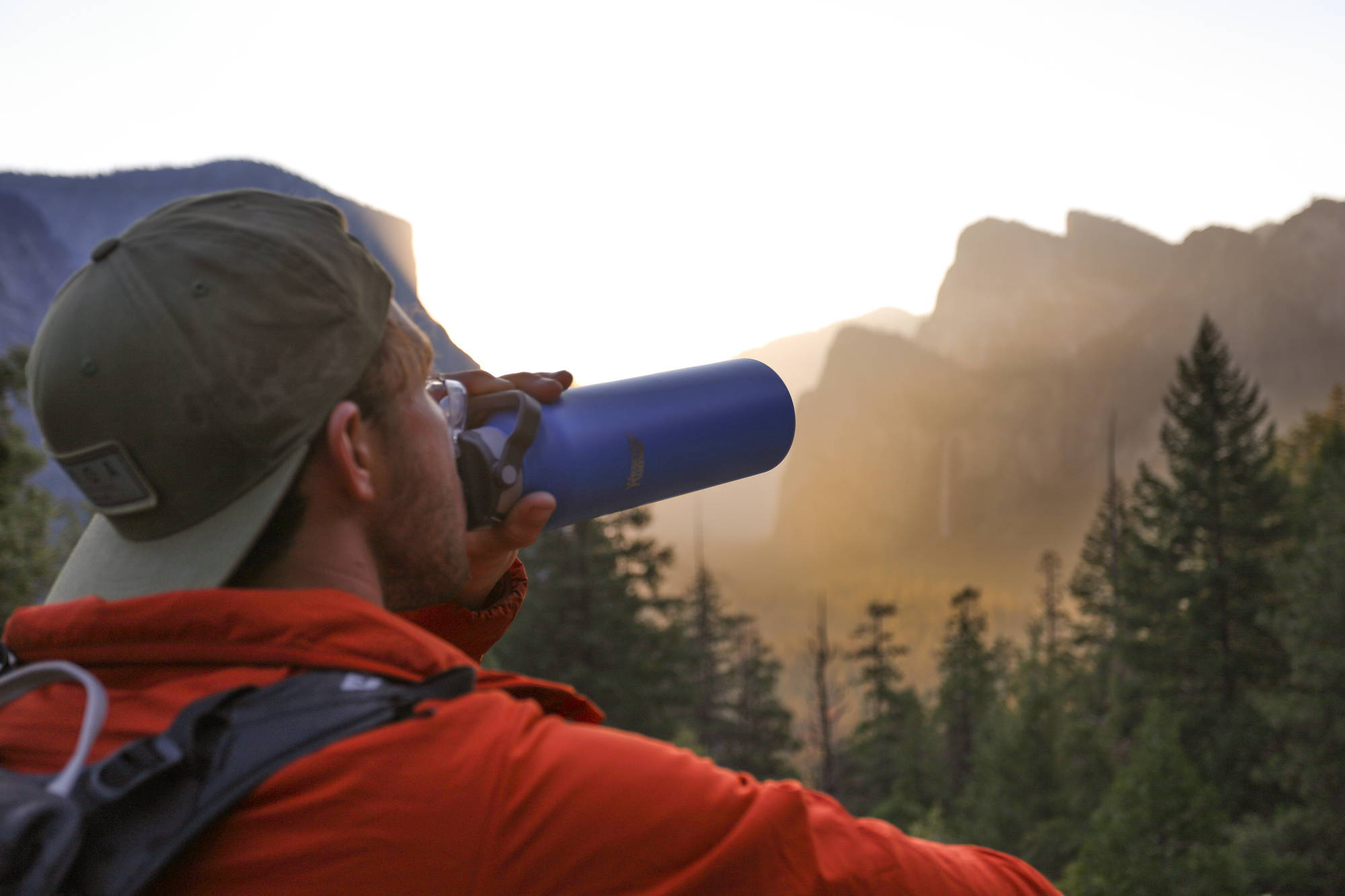 man drinking fom a Healthy Human water bottle in Yosemite
