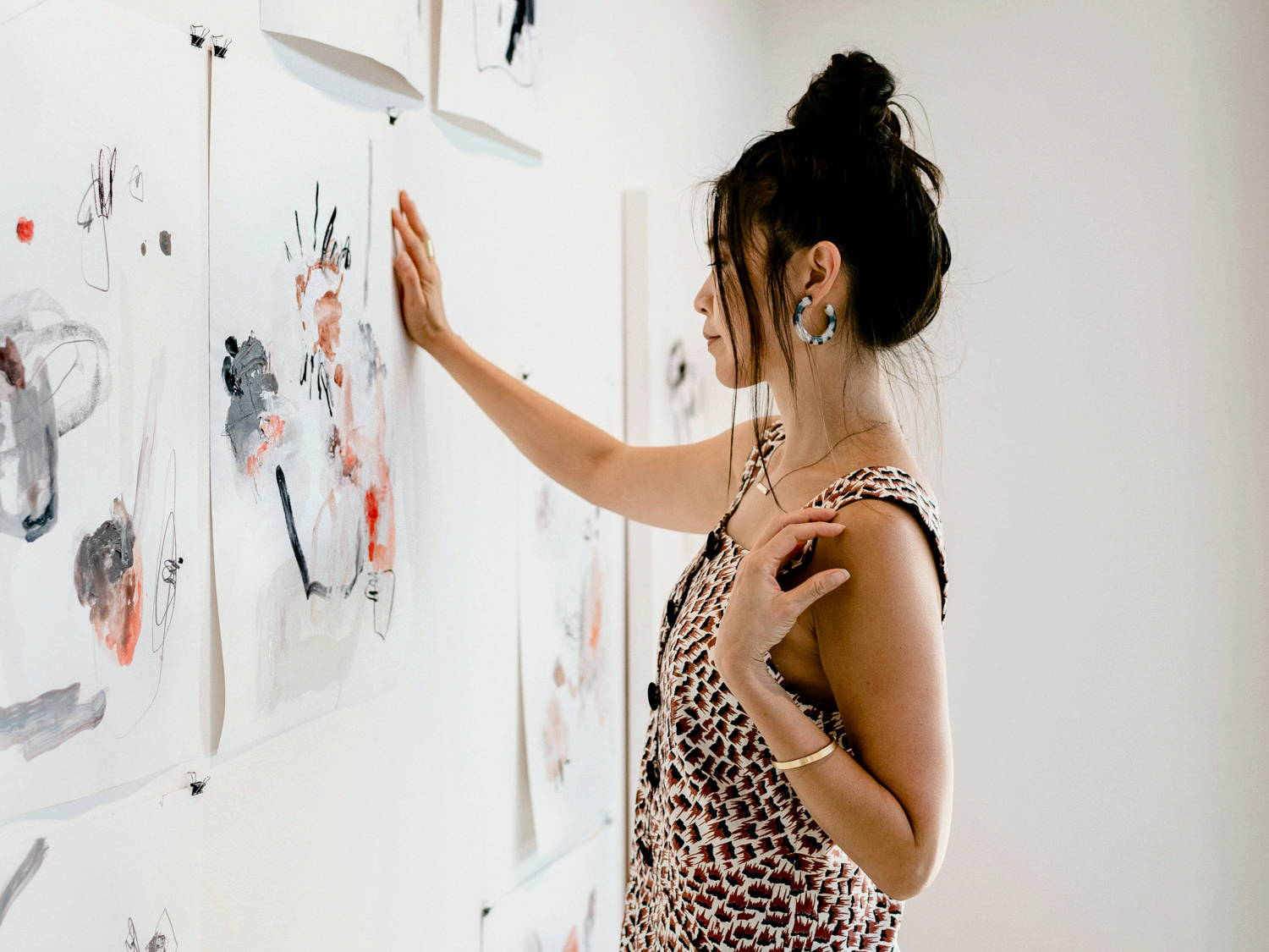 Picture of Natalie Shaw looking at her paintings