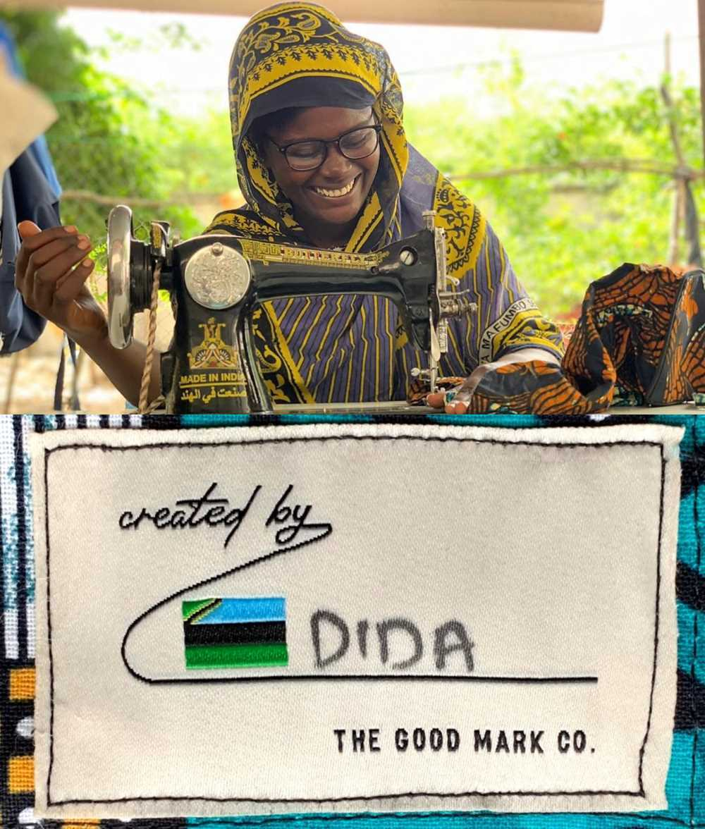 Dida, a creator from Zanzibar, is sewing her labels onto a bag.