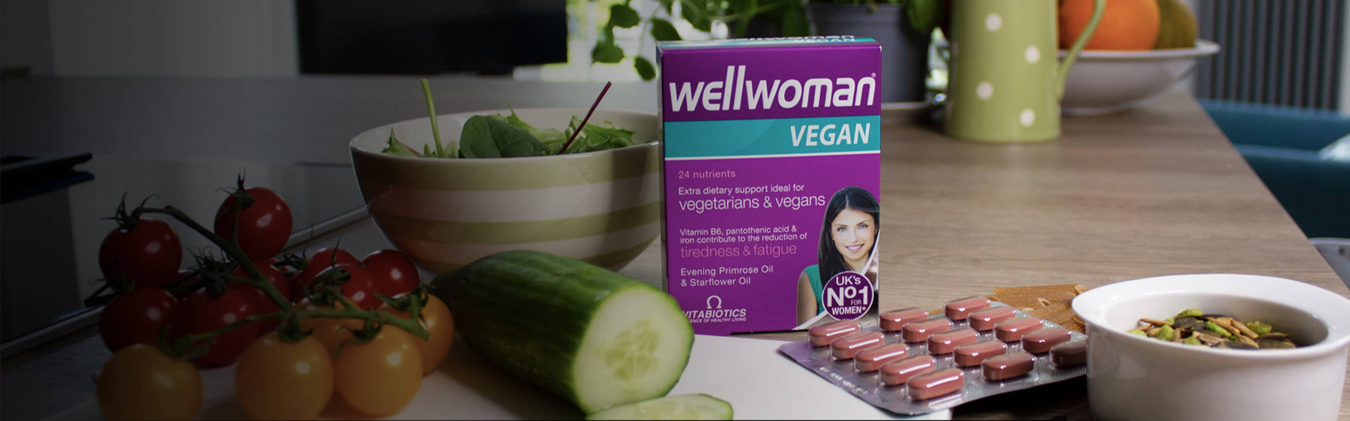 Wellwoman Vegan Pack Next To Vegetables & Nuts