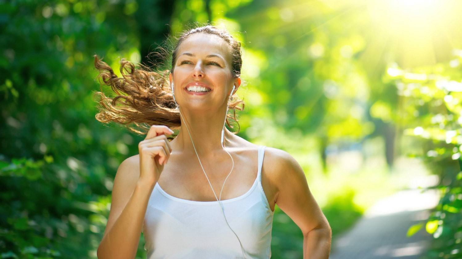 Female Runner Jogging during Outdoor Workout in a Park   Can't Lose Weight? Try These Best Ways to Lose Weight, Tone, and Slim Down Naturally   Featured