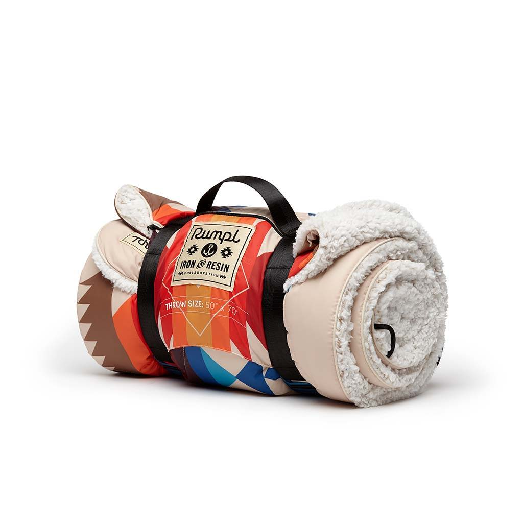 Rumpl x Iron & Resin Land & Sea Sherpa Blanket Roll-up straps for easy carrying