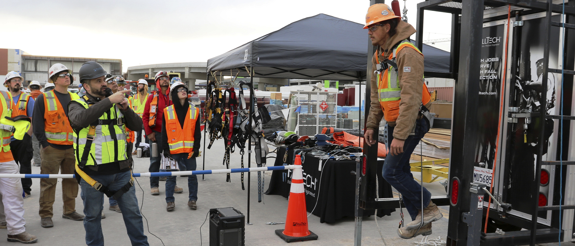 FallTech Regional Sales Manager Mike Tavis teaching a group of construction workers the importance of trauma relief when suspended from a fall protection harness