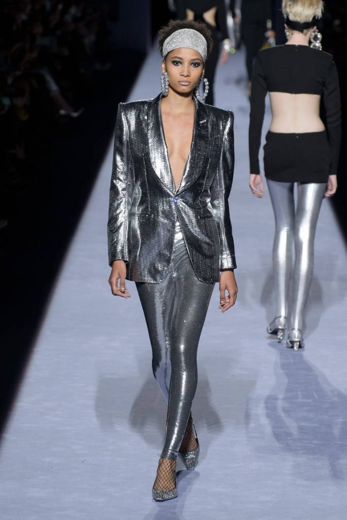 Girl on runway in metallic suit