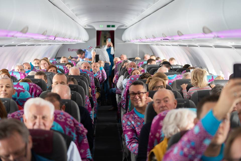 Passengers wearing Eurowings Custom Christmas Sweaters