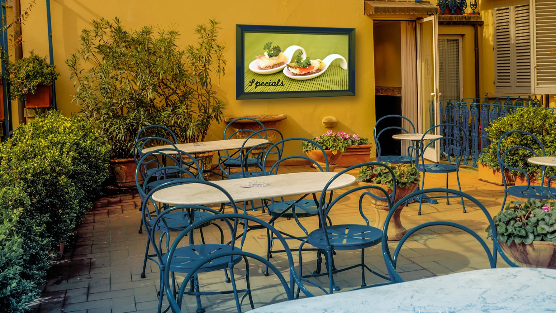 Custom color outdoor TV cabinet on patio at eatery
