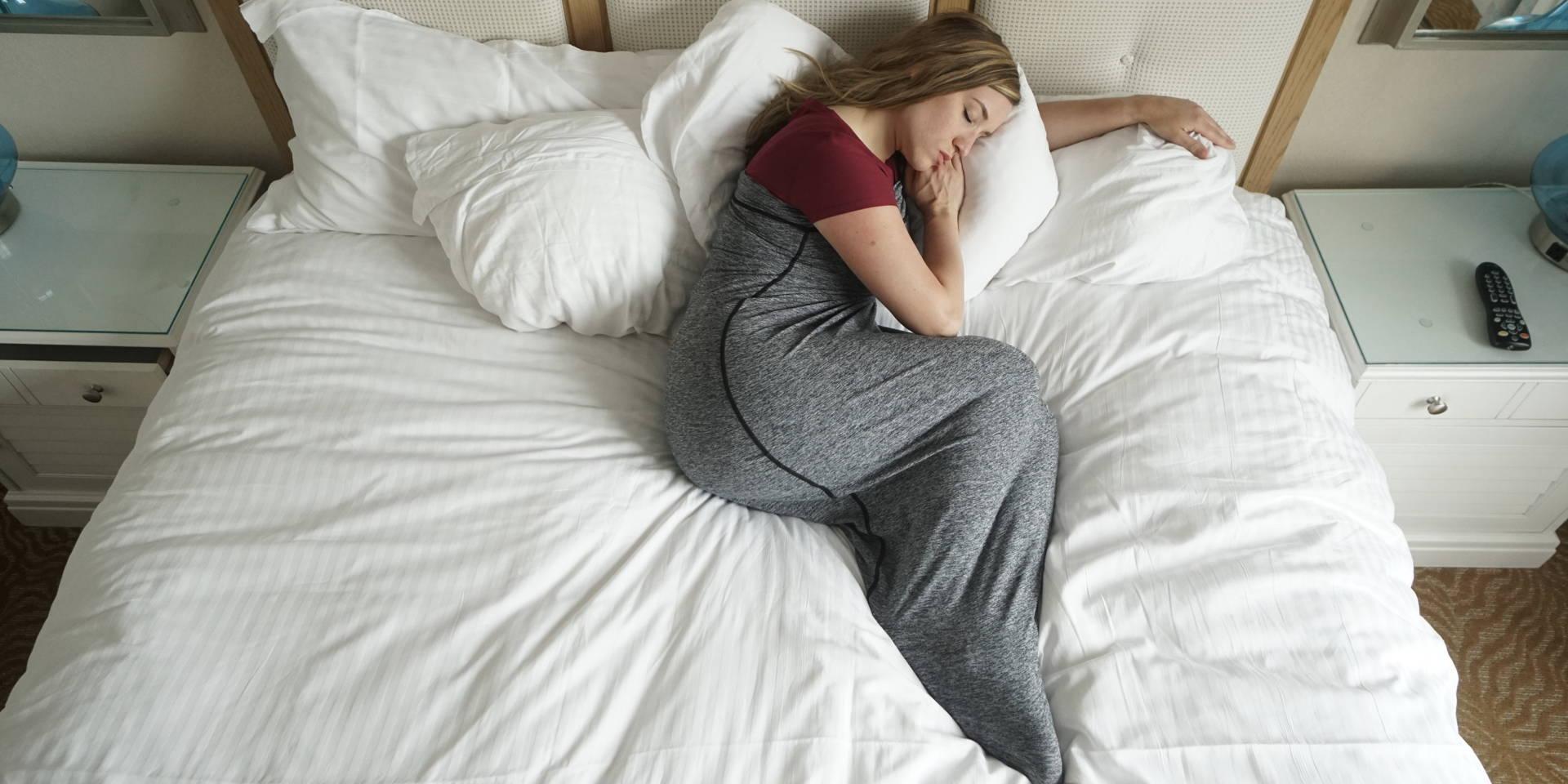 woman sleeping in sleep pod