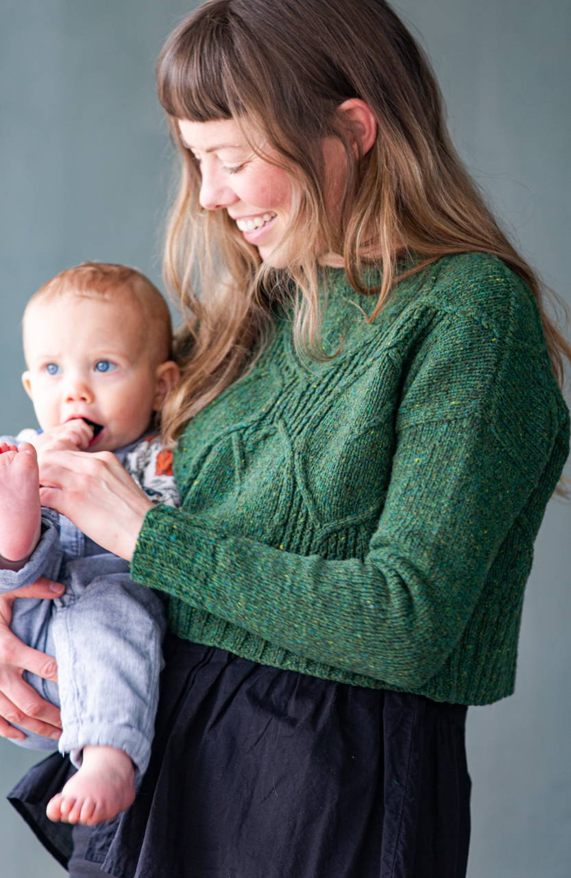 Image of Alyssa modeling Broadleaf while holding her baby